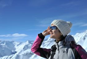 Woman wearing sunglasses in winter